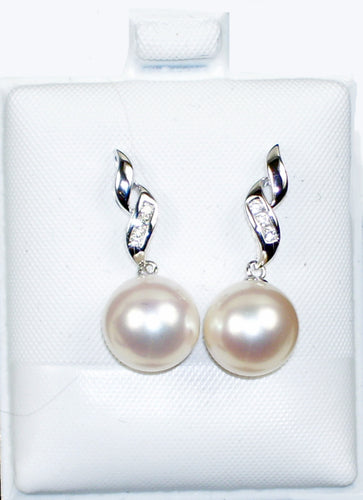 AAA grade white freshwater white pearl earrings with diamond accent set in 14kt. white gold