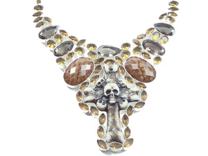 Hand Crafted bone skull and cross pendant accented with gemstones