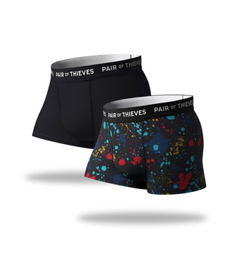 SuperFit Trunks 2 Pack, black and colorful paint splatter pattern
