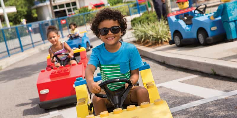 LEGOLAND® California Resort - Kids driving cars at Driving School in Fun Town