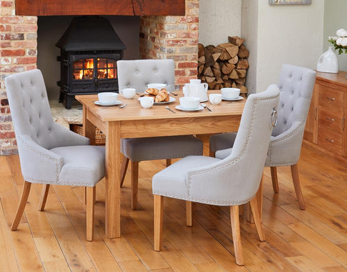 Oak 150cm table with 4 walnut upholstered light grey chairs