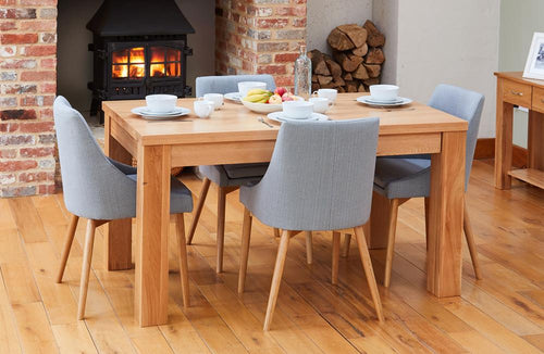 Oak extending table with 4 walnut grey chairs