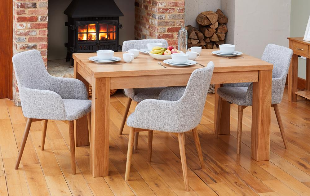 Oak extending table with 4 walnut light grey chairs