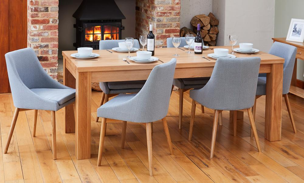 Oak extending table with 6 walnut grey chairs
