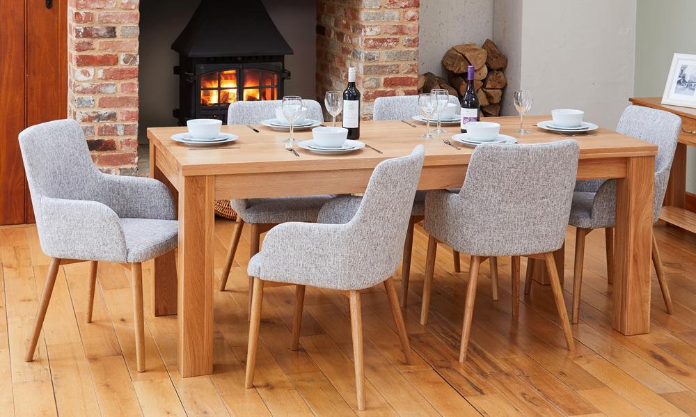 Oak extending table with 6 walnut light grey chairs