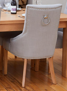 Oak extending table with 6 walnut upholstered light grey chairs