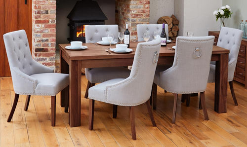Walnut extending table with 6 walnut upholstered light grey chairs