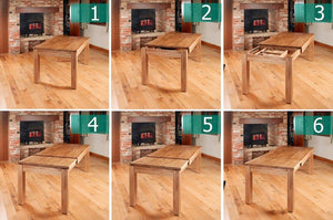 robin hidden extending oak dining table seats 4 8