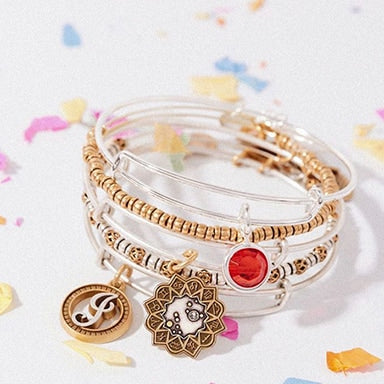 Two bracelets with birthstones and zodiac signs