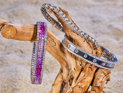 Bracelets sitting on driftwood