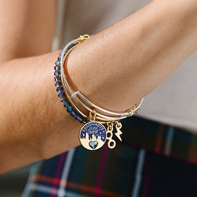 Woman wearing two Harry Potter bracelets