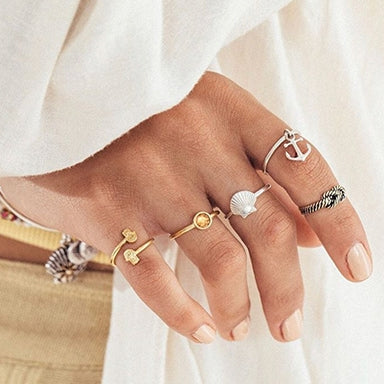 Woman wearing ALEX AND ANI rings on each finger