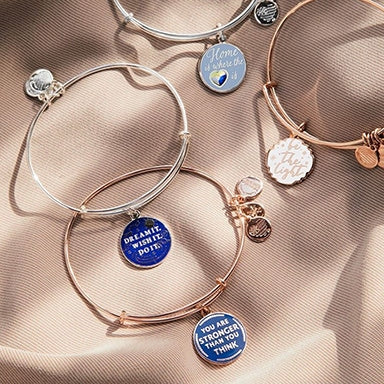 Four ALEX AND ANI bracelets with messages