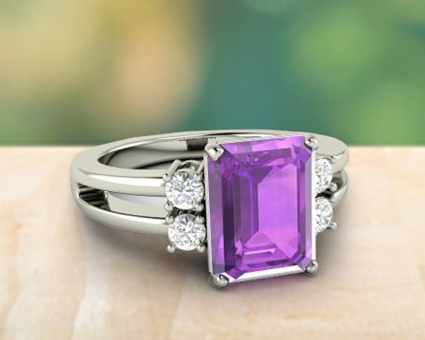 Amethyst gemstone in a silver band with white diamonds