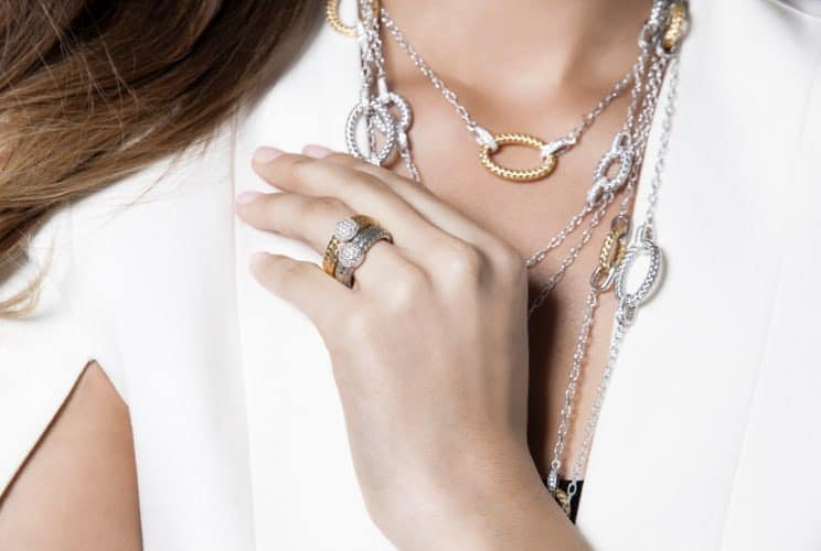 Woman wearing Charles Garnier rings and necklaces