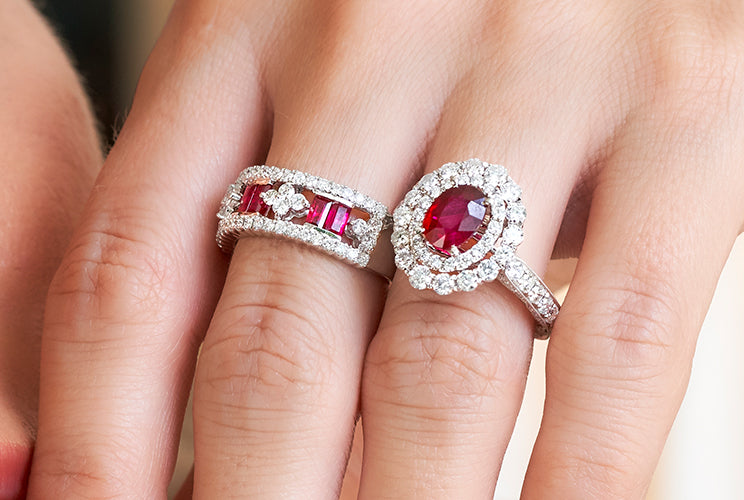 Woman's hand with ruby rings