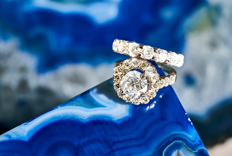 Diamond rings sitting on a blue rock