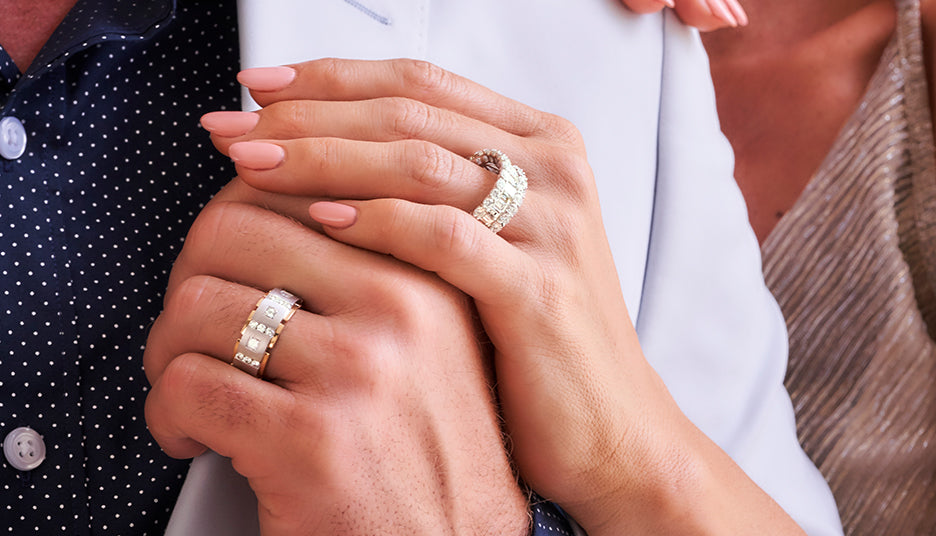 Woman and man wearing diamond rings