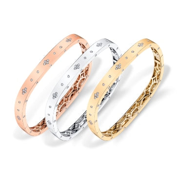 Luxury by Design gold, silver, and bronze bracelets