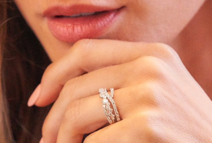 Woman's hand wearing an eternity ring