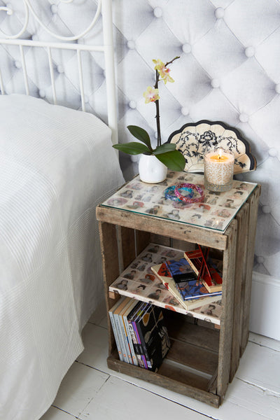 Vintage apple crates can be upcycled into bedside tables with a storage shelf and glass top.