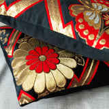 Black silk pillows with gold and red accents