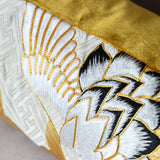 Gold couchwork pillow