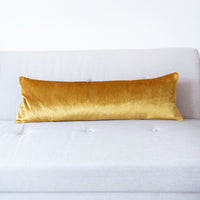 Long bolster pillow with gold velvet reverse