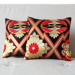 Pair Obi cushions in black red gold