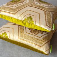 Small designer throw pillows in gold silk
