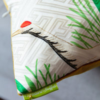 Gold thread crane, hand-painted green reeds.