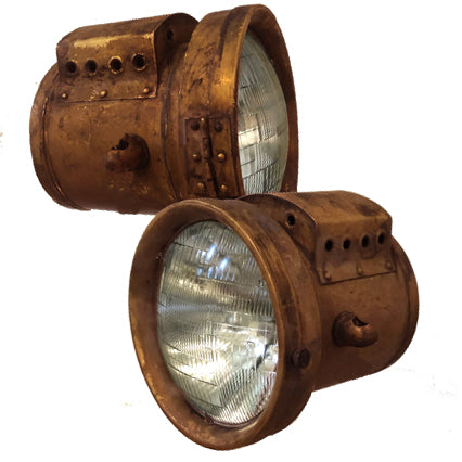 brass headlights with a patina finish