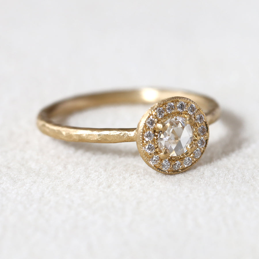 0.14ct colorless diamond halo ring