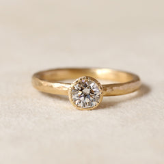 Tapered bezel diamond ring