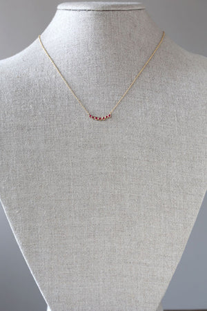 Curved 7 bezel ruby necklace