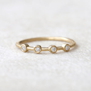 0.08ct 4 bezel ring