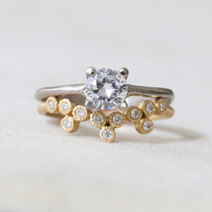 11-bezel curve ring