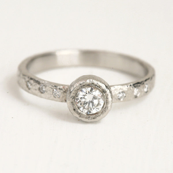 Platinum 4mm diamond ring