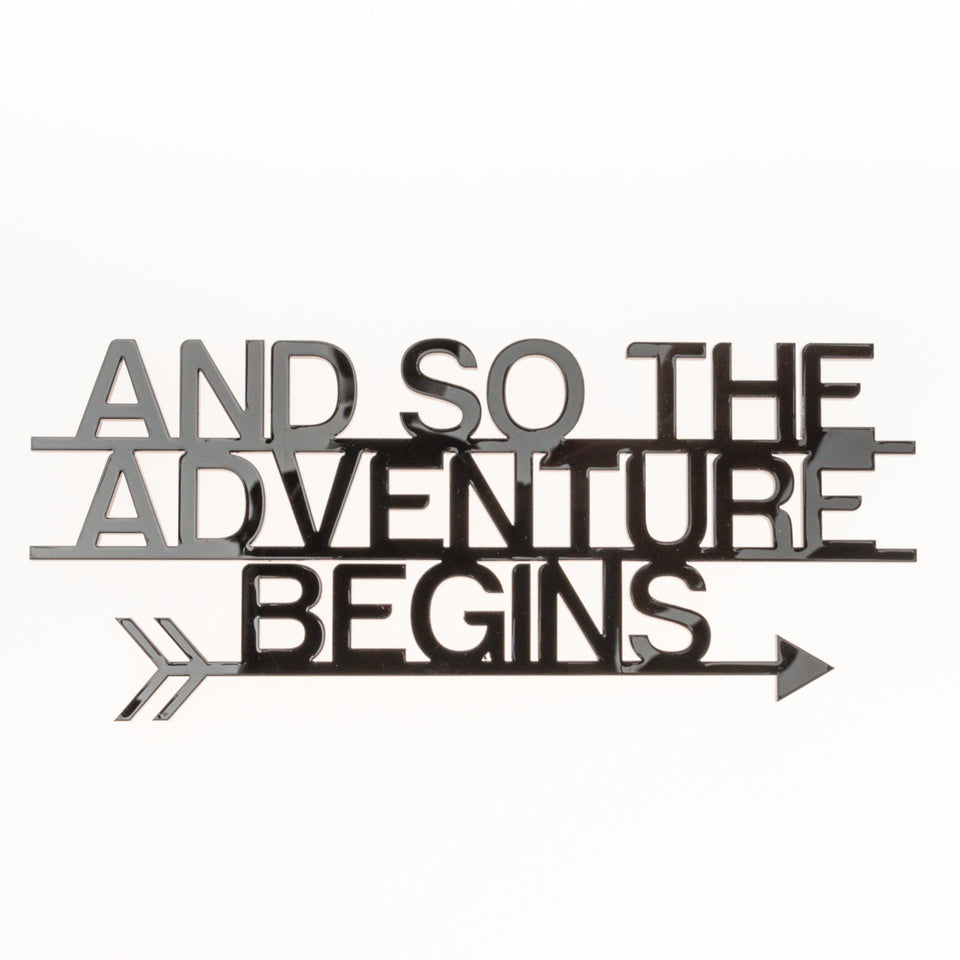 """And so the Adventure begins"" Schriftzug"