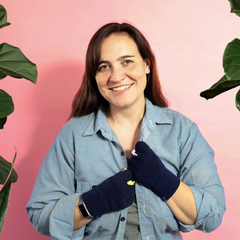 Owner, Susie Moschkau wearing, Thank you, Next Navy fingerless gloves
