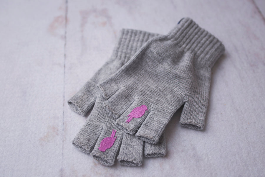 Two stacked Grey Fingerless Gloves with a Pink colored bird on the middle finger