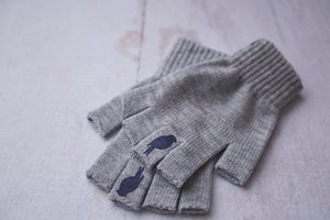 Grey Fingerless Gloves with a Navy colored bird on the middle finger; Nail color Dark Red