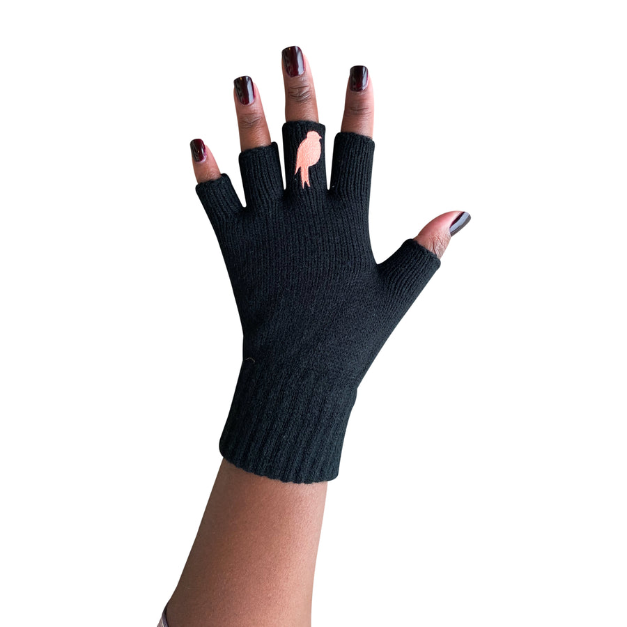Black Fingerless Gloves with a Coral colored bird on the middle finger; Nail color is a dark red