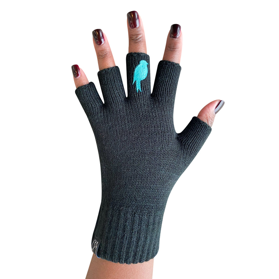 Black Fingerless Gloves with a teal colored bird on the middle finger; Nail color is a dark red