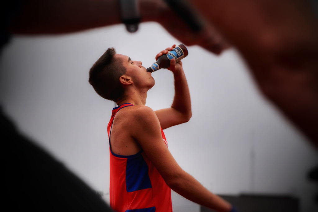 Chris Robertson Chugs Blue Moon in Beer Mile American Record