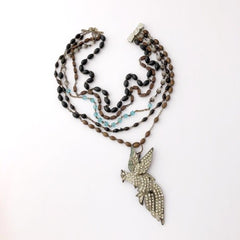 repaired beaded necklace with bird centerpeice