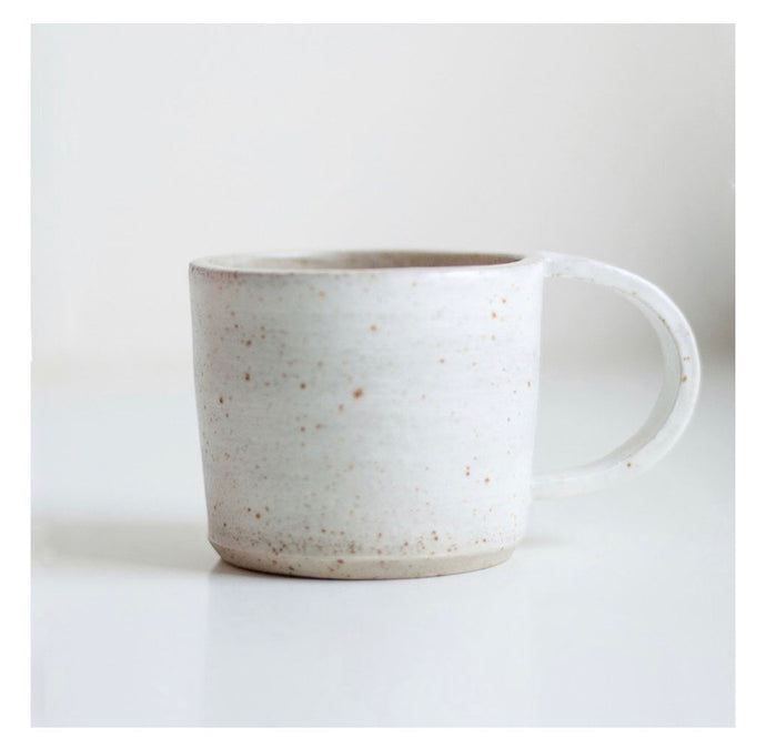The handmade cups are made of speckled stoneware with a white layer on the outside. The cup is then finished with a glossy or matt glaze.  Dimensions cup: Height about 7.5 cm 8.5 cm in diameter  Preferably wash by hand, dishwasher is not recommended