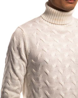 SWEATER WITH SMALL WHITE BRAIDS