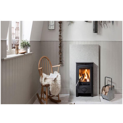 Arada Ecoburn Plus Inset Wood Burning Fire Stove Sheepskin on Rocking Chair Beside Fire in Cosy Grey Room