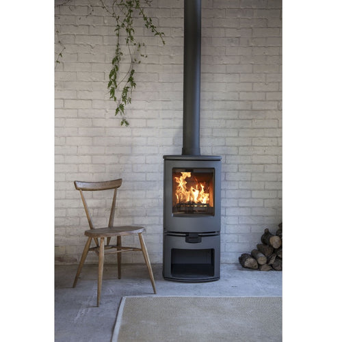 Charnwood Arc 5 woodturning stove fire in white brick stacked wall  Edit alt text